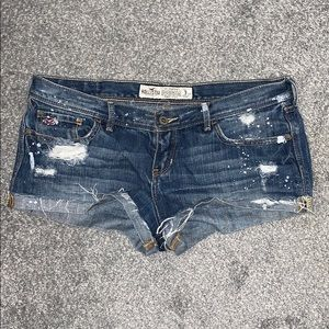 Hollister ripped and paint splattered Jean shorts